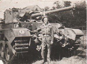 Private Daniel Dunlop pictured beside a tank.