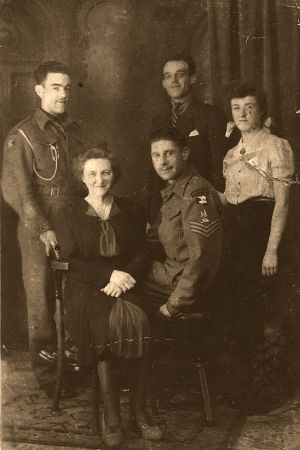 Family photo featuring Staff Sergeant Dick Ashcroft -standing at left.